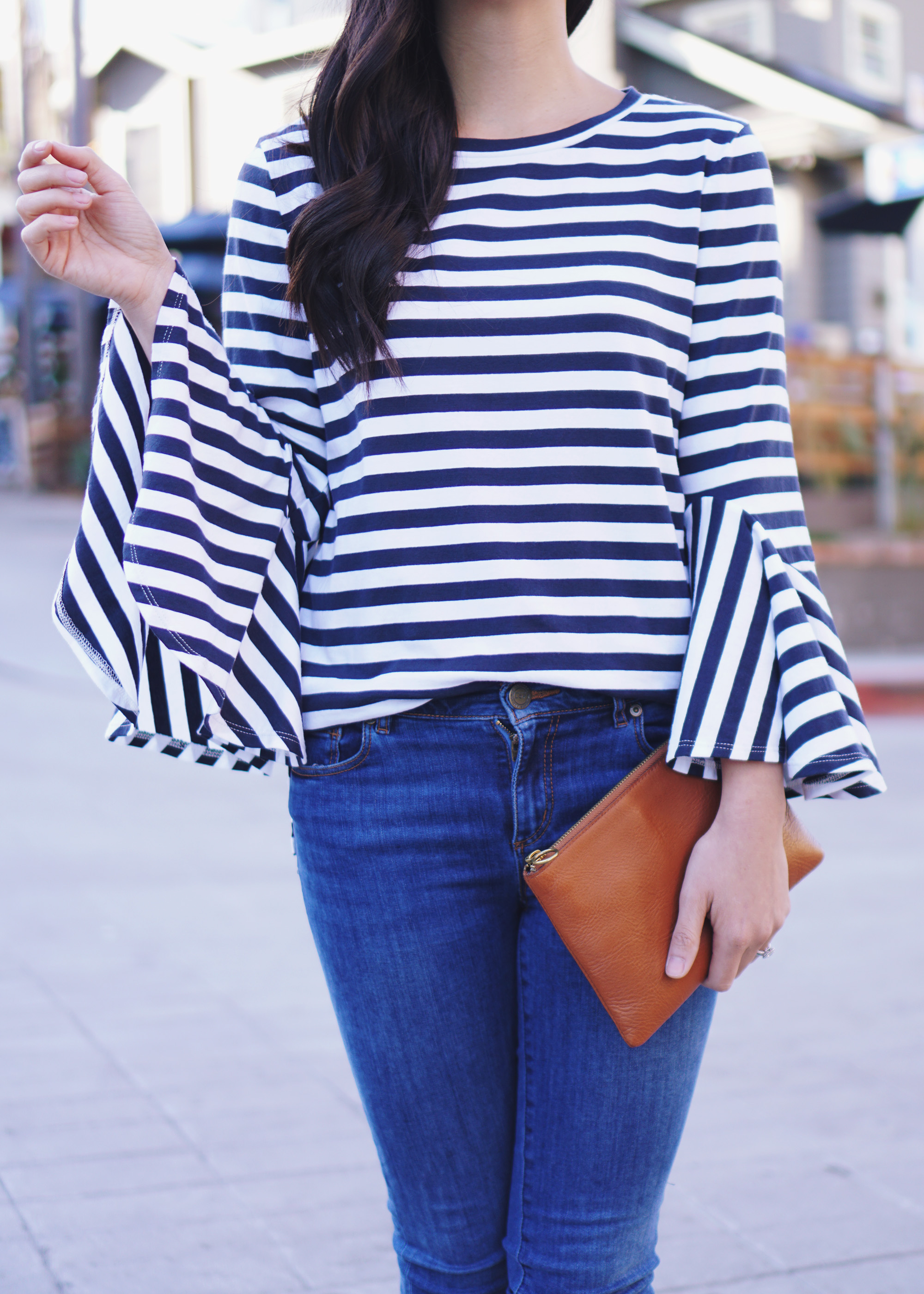 Striped Bell Sleeve Top & Brown Leather Clutch