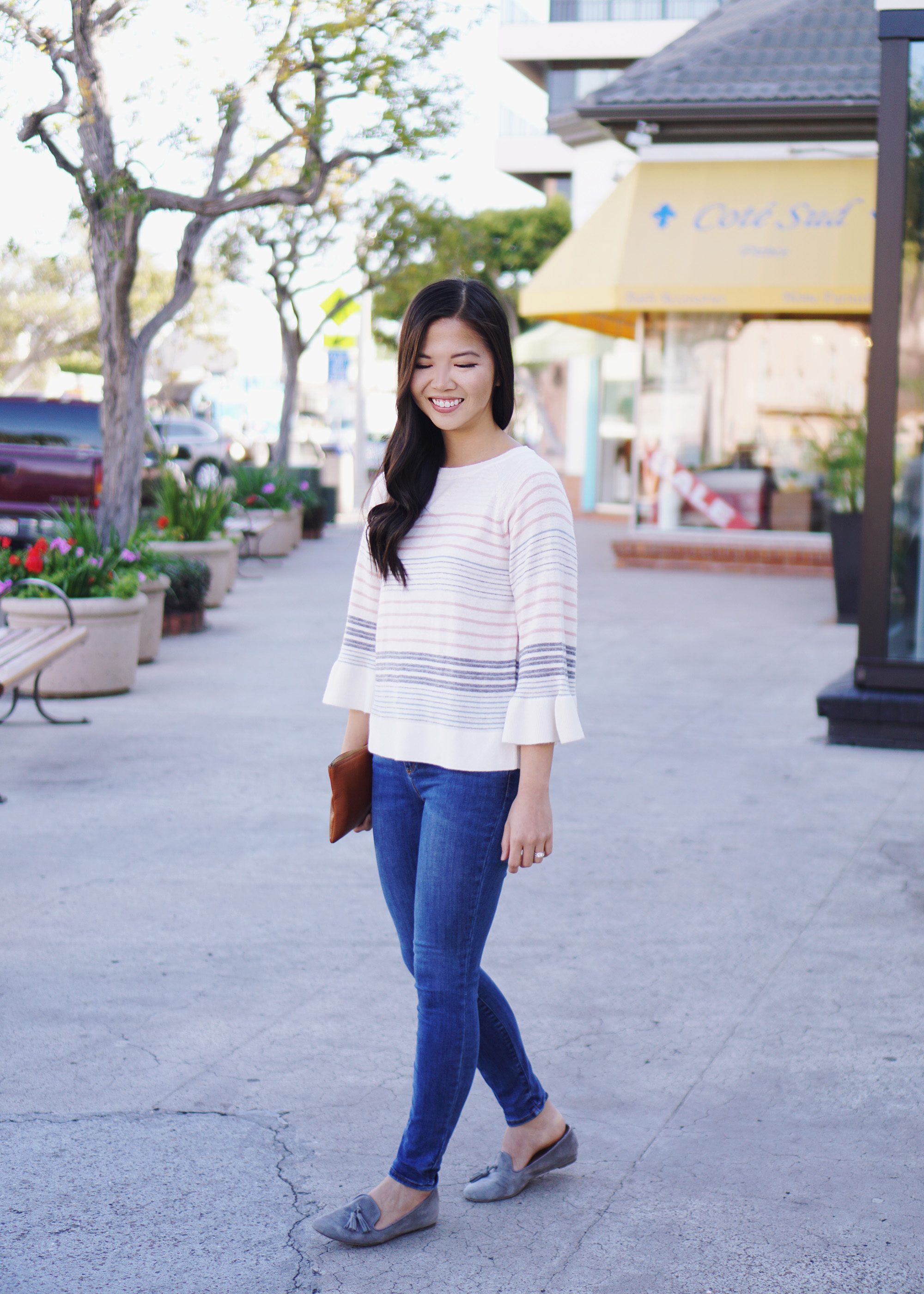 082e41e32d1 A Slow Transition to Spring. Spring Outfit   Pastel Striped Sweater    Skinny Jean