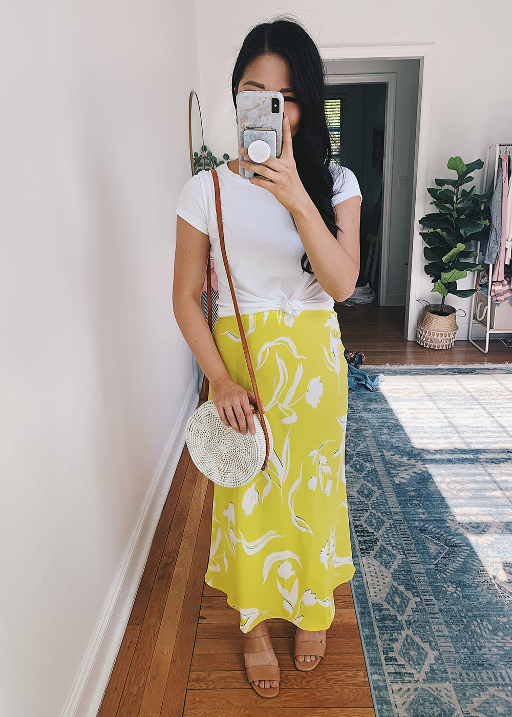 Casual Spring Outfit: White Knotted T-Shirt, Bright Yellow Floral Midi Skirt, White Straw Circle Bag