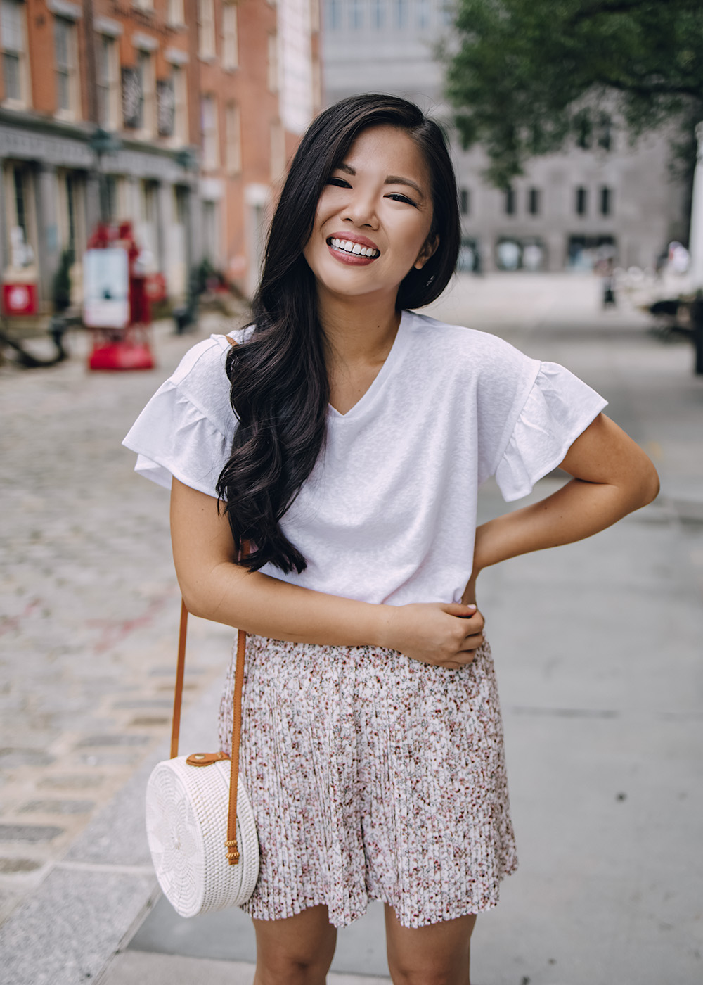 Casual Summer Outfit Ideas for Women: White Ruffle T-Shirt and Floral Shorts